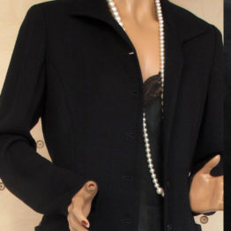 Long black coat. Joan Helpern